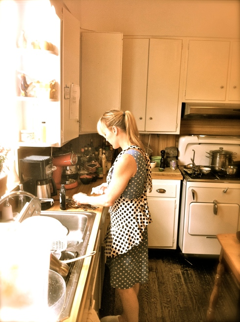 Rocking the polka dot power play Lisa, busy preparing breakfast on a Saturday morning, has no idea that today isMoroccan Braised Goat Day.
